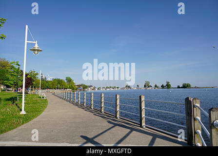 Waterfront trail through park, yachts and marina in Frenchmen's Bay, Pickering, Ontario, Canada in summer - Stock Image