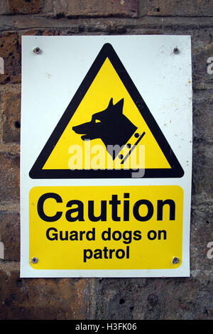 Caution GUARD DOG PATROL ! warning sign - Stock Image