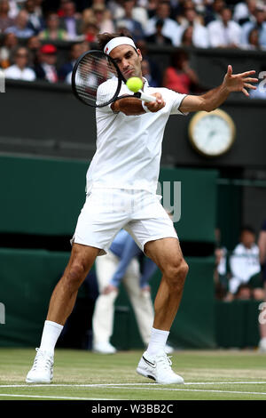 London, UK. 14th July 2019. Wimbledon Tennis Tournament, Day 13, mens singles final; Roger Federer (SUI) with a forehand to Novak Djokovic (SER) late in the first set Credit: Action Plus Sports Images/Alamy Live News - Stock Image