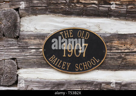 The Old Baily School House historical marker. 1907-1941. A one-room log schoolhouse built in 1907. It is now part of Sturgeon Point State Park. Harris - Stock Image