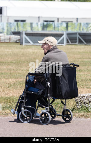 An elderly man alone in a wheelchair - Stock Image