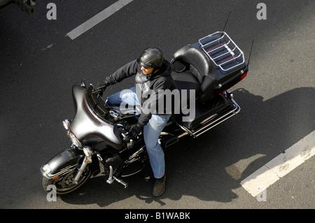 man on huge motorbike aerial berlin germany deutschland - Stock Image