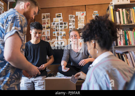 Creative business people playing cards in office - Stock Image