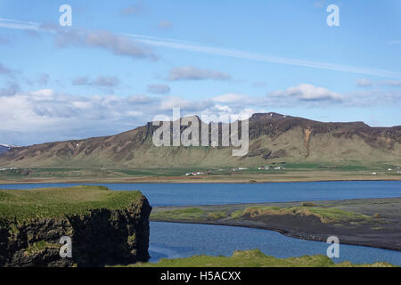 South Icelandic landscape with sea and mountain range [looking North] - Stock Image