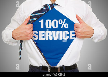 Business man opens shirt and wears lettering 100% service underneath as quality concept - Stock Image