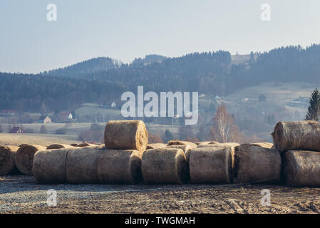 Straw bales in Sokolec village in Landscape Park of Gory Sowie (Owl Mountains) mountain range in Central Sudetes, Poland - Stock Image