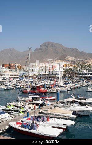 Boats moored in the marina at Puerto Colon in Costa Adeje, Tenerife, Canary Islands - Stock Image