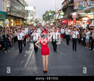 A drum major leading a band during the Chiang Mai Flower Festival parade in Thailand - Stock Image