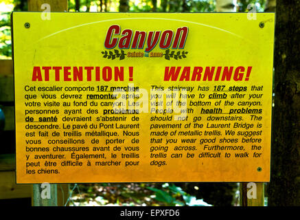 Sign warning steep staircase with many steps Canyon Sainte Anne River Park - Stock Image