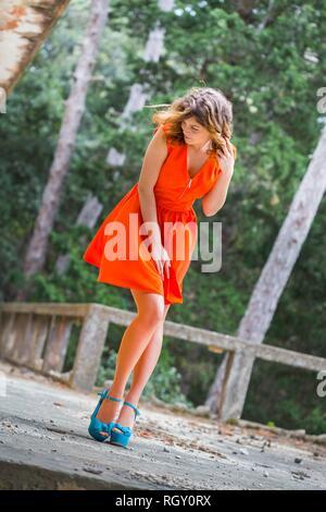 Teen cute beauty female is shy - Stock Image