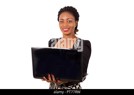 Young businesswoman standing working on laptop, isolated on white - Stock Image