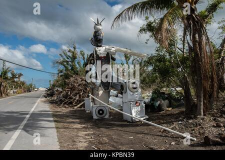 A sculpture assembled from trash and debris sits along the road during relief efforts in the aftermath of Hurricane - Stock Image