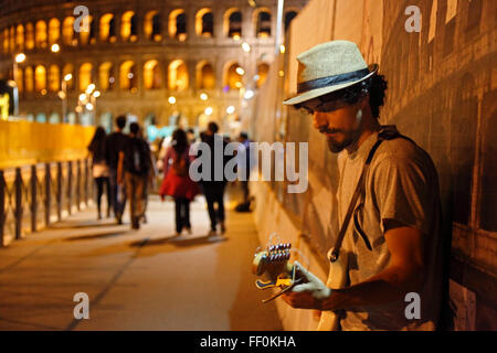 rock guitarist at the Colosseum in Rome, Italy - Stock Image