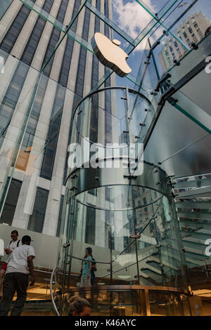 Tourists in the famous glass stairs of the the cube, Apple Store in 5th avenue, Manhattan, New York City. - Stock Image