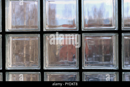 View through a window made of multiple transparent glass squares. Between those symmetric squares is back supportive structures. - Stock Image