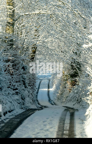 Snow covered country road, County Mayo, Republic of Ireland. - Stock Image