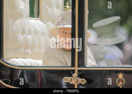 Her Majesty, Queen Elizabeth II, rides along The Mall in the Scottish State Coach. Trooping the Colour, The Queen's Birthday Parade - Stock Image