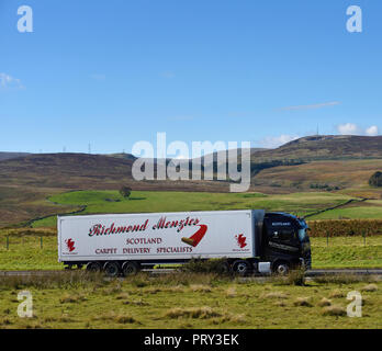 Richmond Menzies Scotland Carpet Delivery Specialists HGV. M6 Northbound carriageway, Shap, Cumbria, England, United Kingdom, Europe. - Stock Image