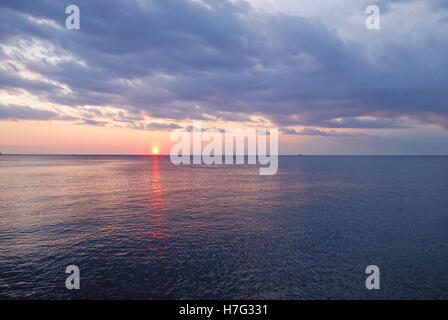 sun over the ocean at sunset in summer - Stock Image