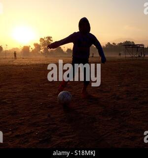 Boy playing football - Stock Image