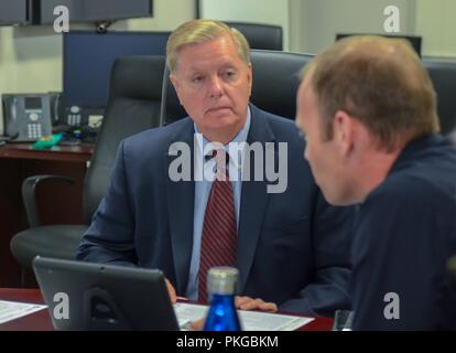 FEMA Administrator Brock Long, right, briefs U.S. Sen. Lindsey Graham of South Carolina to discuss the efforts of FEMA and federal partners in support of Hurricane Florence at the National Response Coordination Center September 13, 2018 in Washington, DC. - Stock Image