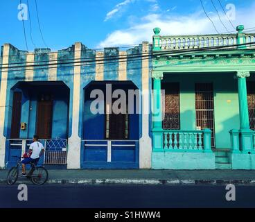 Young man on bike in street of Pinar Del Rio Cuba - Stock Image