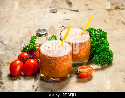 Vegetable smoothie in glasses . On a wooden background. - Stock Image