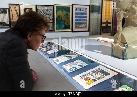 Leopold Museum Vienna, view of a woman looking at a display case containing original commercial artwork by Secession artists in the Leopold Museum. - Stock Image