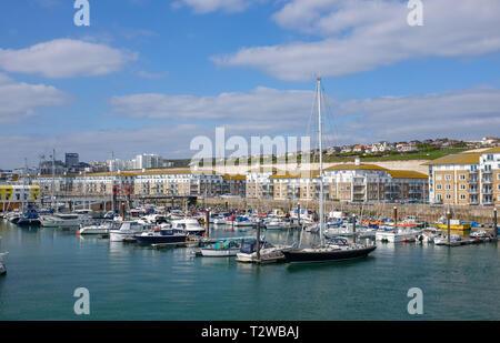 Brighton Marina Views UK - Yachts moored in the marina with properties behind - Stock Image