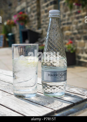 Harrogate Spa Sparkling mineral water, The Original British Spa Town Spring Water since 1571 bottle and glass ice and lemon - Stock Image