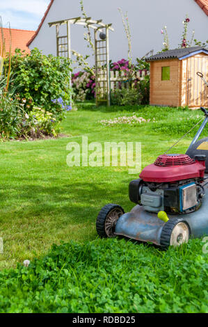mowing the lawn in my garden - Stock Image