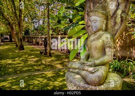 Stone image of meditating Buddha in Mendut temple, Indoensia - Stock Image