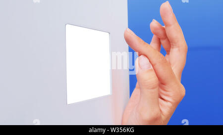 Woman hand using white empty display - Stock Image
