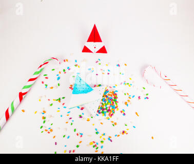 Christmas decoration triangle git boxes with colorful candy as confetti and candy canes for celebration best Christmas - Stock Image