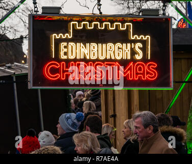 Edinburgh, Scotland, United Kingdom, 8th November 2018. Christmas celebrations: A busy Saturday in the capital city centre at Edinburgh's Christmas celebration venues. The entrance to the Christmas market in Princes Street Gardens is packed with people - Stock Image