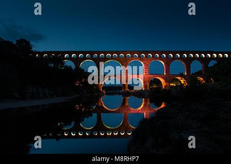 Pont du Gare (Roman aquaduct) illuminated at night, France - Stock Image
