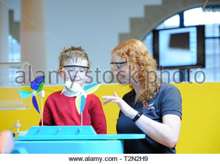 Edinburgh, UK. 3rd April, 2019.  Edinburgh, UK. 3rd April, 2019.  Colin from Royal Mile Primary School listens as Rosie from EDF Energy explains win turbine technology at ÒEnergy Makers Ò a new workshop at the City Art Centre (CAC) presented by the FestivalÕs headline sponsors, EDF Energy. Credit: Roger Gaisford/Alamy Live News - Stock Image