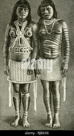 Two Waiwai girls with their bodies painted for performing a dance, Brazil. - Stock Image