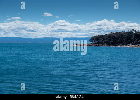 Coastal views in the Freycinet National Park, Tasmania on a summer day with blue sky - Stock Image
