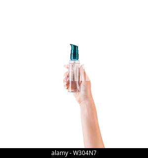Female hand holding cream bottle of lotion isolated. Girl give tube cosmetic products on white background. - Stock Image