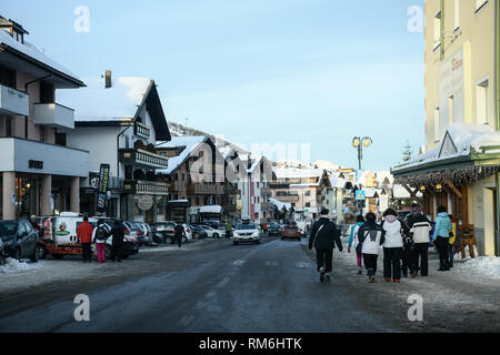 Passo del Tonale, Italy: February 08, 2019: People in the village of Passo Tonale in the Adamello mountains, The Alps, Italy. - Stock Image