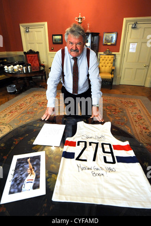 Mayor of Brighton and Hove Cllr Bill Randall with the running vest Steve Ovett wore when he won the Olympic Gold - Stock Image