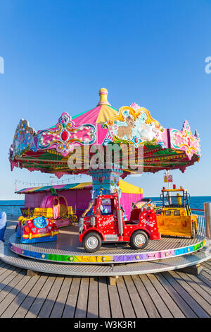 Children's carousel merry-go-round roundabout on Bournemouth Pier,  Bournemouth, Dorset UK in July - Stock Image