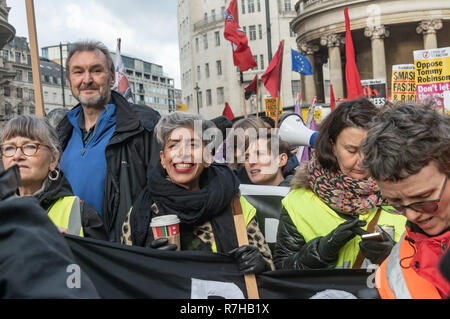London, UK. 9th Dec, 2018. Protesters line up close to the BBC for the united counter demonstration by anti-fascists marches in opposition to Tommy Robinson's fascist pro-Brexit march. NEU General Secretary Kevin Courtney and Nita Sanghera of UCU at left. The march which included both remain and leave supporting anti-fascists gathered at the BBC to to to a rally at Downing St. Police had issued conditions on both events designed to keep the two groups well apart. Credit: Peter Marshall/Alamy Live News - Stock Image