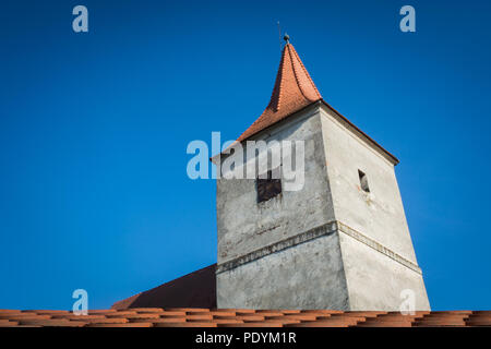 Old church tower and blue sky - Stock Image