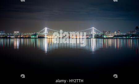 Illuminated City At Waterfront - Stock Image