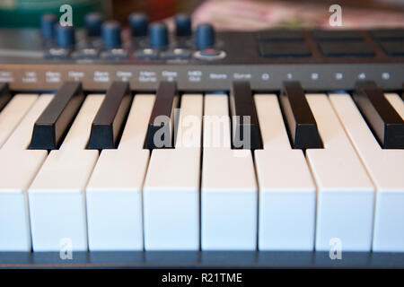 A piano keyboard with dials for creating sounds and music - Stock Image