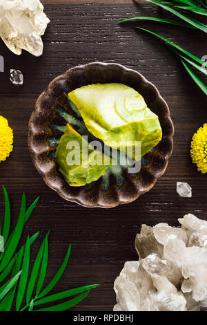 Green Opal with Smoky Quartz and Mums on Dark Wood - Stock Image