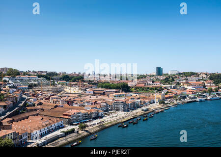 View from the Luis 1 bridge, Porto, looking over the port houses of Vila Nova de Gaia. - Stock Image