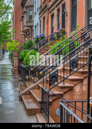 Brownstone on upper East side of New York City on rainy day - Stock Image